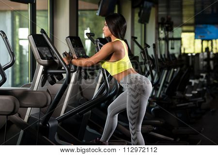 Latino Women On Elliptical Treadmill In Fitness Gym