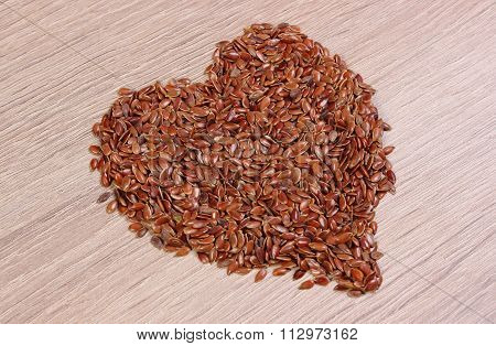Heart Of Linseed On Wooden Background