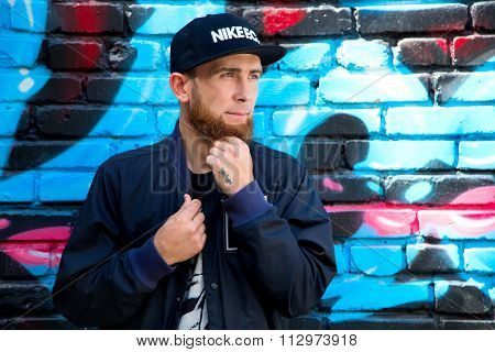 The bearded man in a cap