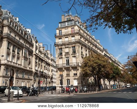 PARIS, FRANCE - SEPTEMBER 9, 2014: facade of typical house with balcony in Paris France