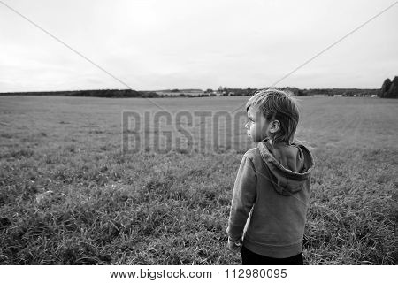 Handsome Young Boy Looks At The Field And Dreams.