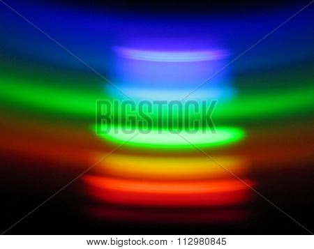 Abstract pattern of vibrant colours reflected from back side of DVD dics