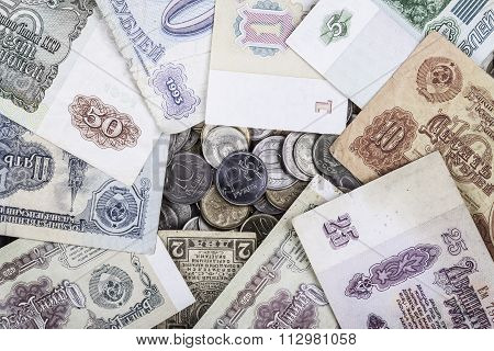 modern coin ruble surrounded by old banknotes of the USSR