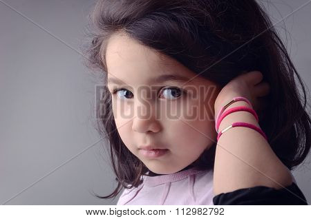 Afraid Kid Close Her Ear With Her Hand