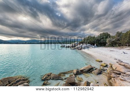 Boulders In A Turquoise Sea At Santa Giulia Beach In Corsica