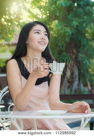 Asian Woman Drinking Coffee.she Get Happy Lifetime.