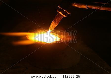 Acetylene Torch Smelting Hot Precious Metals Down