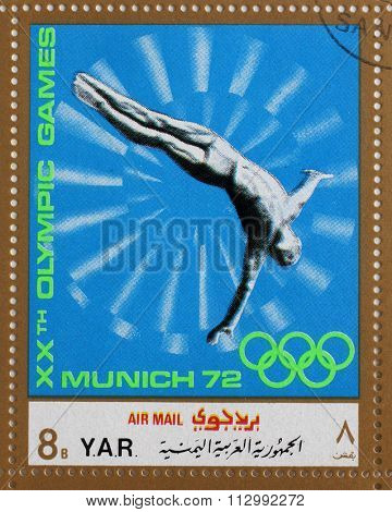 YAR - CIRCA 1972: A stamp printed in Yemen Arab Republic shows jump into the water, Olympics in Munich, circa 1972