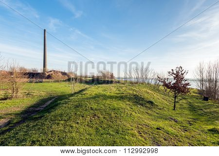 Undulating Landscape With An Old Brick Factory