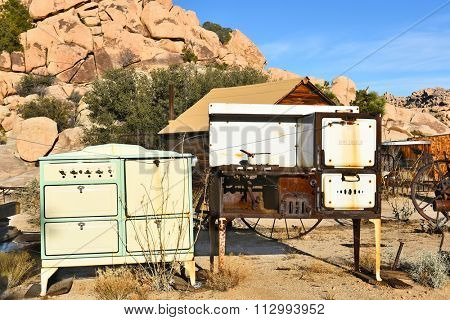 JOSHUA TREE, CALIFORNIA - JANUARY 1, 2016: Old Stoves at Keys Ranch. The property is littered with items collected by homesteader Bill Keys.