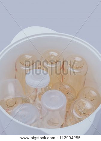 Milk Bottles In Steam Sterilizer And Dryer.
