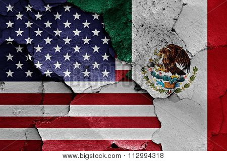 Flags Of Usa And Mexico Painted On Cracked Wall