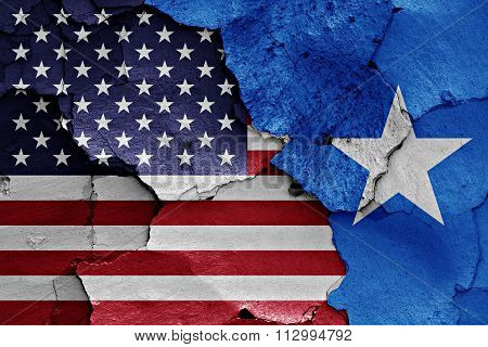 Flags Of Usa And Somalia Painted On Cracked Wall
