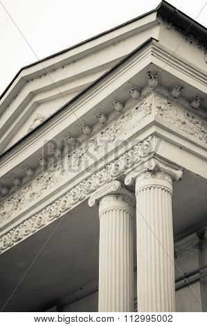 Black And White View Of A Couple Of Pillars. Vertical Black And White View Of A Pair Of Collumns, In