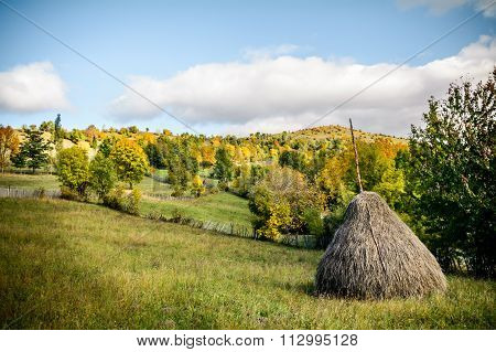Haystack With A Freshly Mown Meadow As Background. Horizontal View Of A Haystack In A Bright Autumn