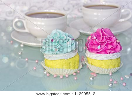 Pink And Blue Muffins And Cup Of Coffee