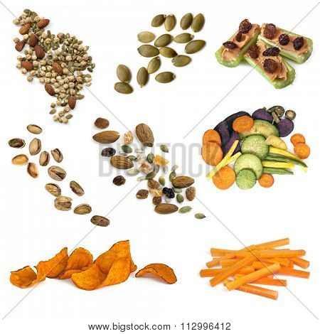Healthy snacking collection isolated on white.  Includes seeds, nuts, trail mix, sweet potato fries, vegetable crisps and carrot sticks.