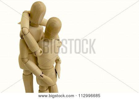 Wooden Dummy Couple Hug Concept