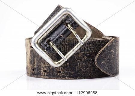 old leather belt isolated on white background