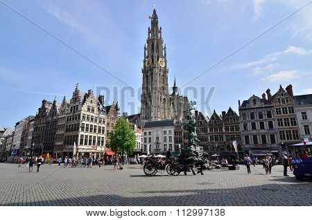 Antwerp, Belgium - May 10, 2015: Tourist Visit The Grand Place With The Statue Of Brabo