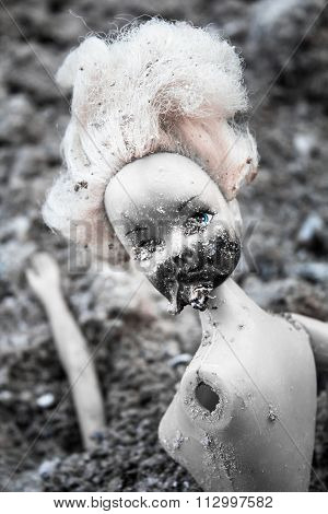 Spooky Plastic Doll On The Pile Of Ash