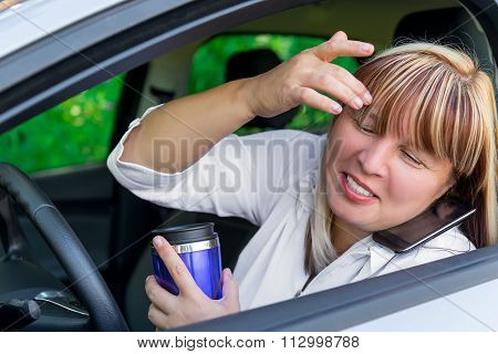 Driver With A Coffee And Phone Does Not Watch The Road