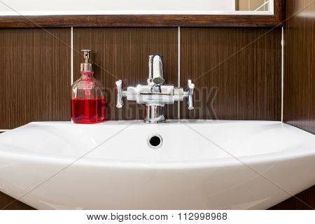 Sink With Shiny Faucet And Soap Close-up