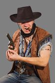 image of wild west  - cowboy with revolver isolated on grey background - JPG