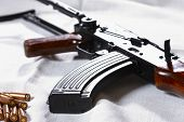 pic of sub-machine-gun  - macro picture of machine carbine with bullet - JPG