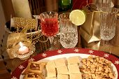 stock photo of christmas party  - party table and christmas dinner with wine tails appetizers and gifts - JPG