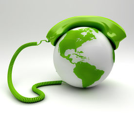 stock photo of long distance  - A global telecommunications concept with a green phone isolated - JPG