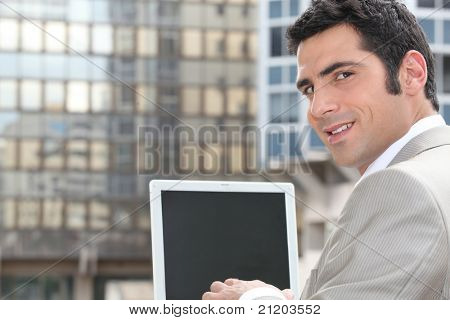 Businessman using a laptop with a blank screen