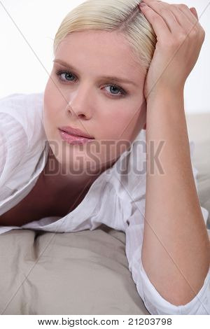 Blond woman laid on bed