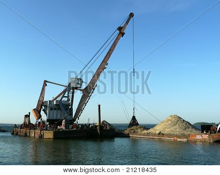Floating dredging platform on the sea