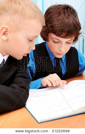 Portrait of a schoolboys in a classroom.