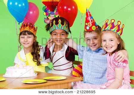 Four friends at the birthday party, embracing