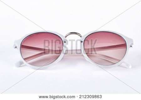poster of Round sunglasses with white rim. Fashion sunglasses with red glass and white plastic rim isolated on white background. Female fashion accessory.