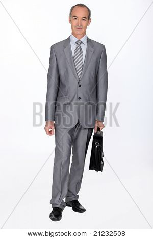 Full length shot of an older businessman with a briefcase