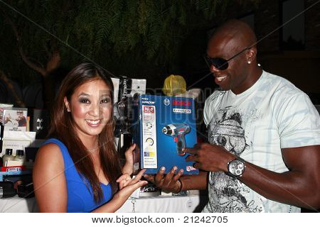 LOS ANGELES - JULY  15: Michelle Kwan and Terrell Owens at the 2008 ESPYs Giant Event in downtown Los Angeles, California on July 15, 2008.