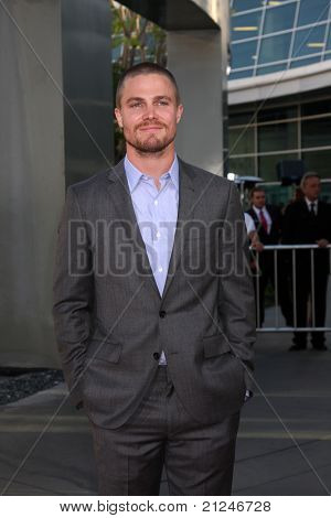 LOS ANGELES - JUN 21:  Stephen Amell arriving at the True Blood Season 4 Premiere at ArcLight Theater on June 21, 2011 in Los Angeles, CA