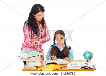 Teacher With Schoolgirl In Classroom