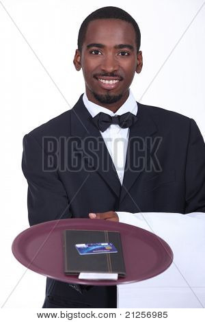 Smart waiter with the bill and a credit card
