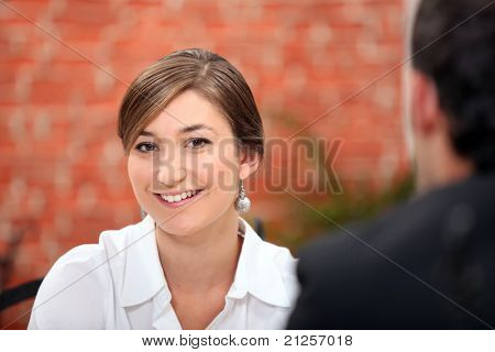Woman sitting in a restaurant with her date
