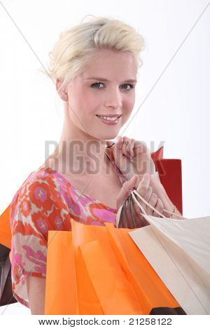 Young woman with store bags