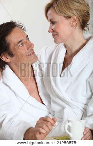 Couple wearing dressing gowns