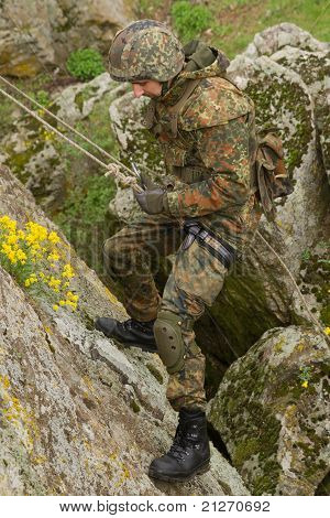 Soldier Climbing Down The Mountain