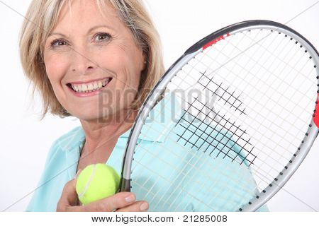 Elderly woman playing tennis