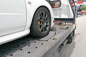 Car Towed Onto Flatbed Tow Truck With Hook And Chain poster