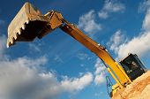 stock photo of risen  - excavator loader machine with risen boom construction site - JPG