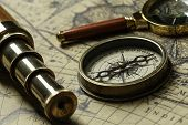 Retro compass with old map and spyglass poster